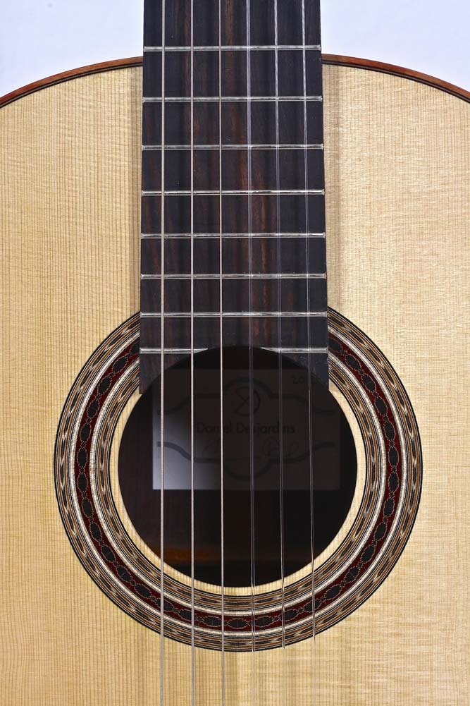 Soundhole and fretboard of classical guitar by luthier Daniel Desjardins